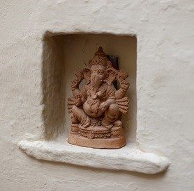 Ganesh statue in niche