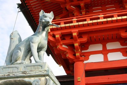 Fox sculture in Fushimi Inari Shrine in Kyoto, Japan