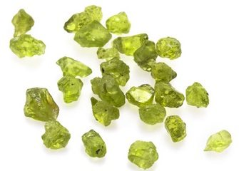 Raw green peridot gemstones